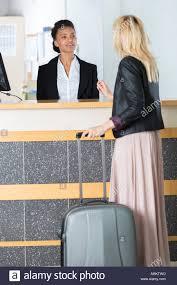 Front Desk Officer Asking A Front Desk Officer Stock Photo Royalty Free Image