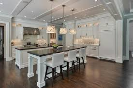white island kitchen side by side white kitchen islands with honed black marble