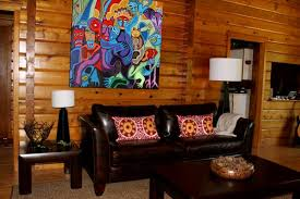 attractive painting interior of log cabins above black leather