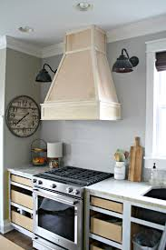 a diy ish wood vent hood from thrifty decor