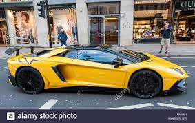 Lamborghini Aventador On Road - london uk 5 april 2016 a bright yellow lamborghini aventador sv