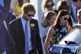 harry and meghan markle prince harry and meghan markle embrace on the steps of pal u0027s