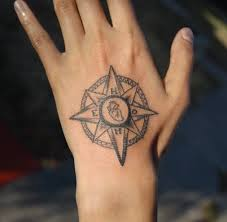 pretty women show outstanding small anchor and compass tattoo