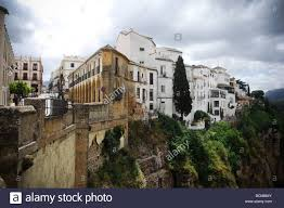 a panoramic view of some old spanish houses built on the edge of a