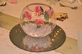 enthralling pink roses lines fish bowl centerpieces wedding table