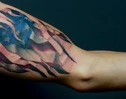american flag tear through bicep tattoo veteran ink