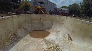 un digging a swimming pool buried 20 years ago total pool remodel