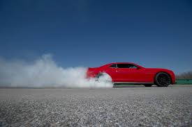 2014 nissan 370z quarter mile the stock chevy camaro zl1 runs the quarter mile in the 11s video