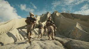squad of fully equipped and armed soldiers walking forward towards