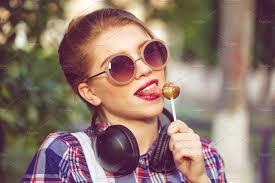 hipster girl hipster girl licking lollipop people photos creative market