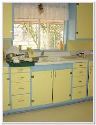with light yellow wall painted and light blue wooden kitchen