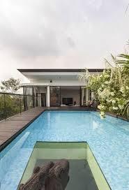 home pool lush gardens and peekaboo roof pool define contemporary home