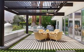 jonathan adler bedding in patio midcentury with covered lanai next