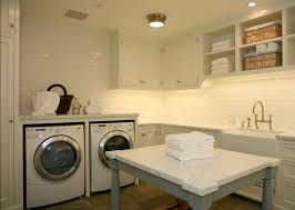 monochromatic white laundry room design with recessed lighting