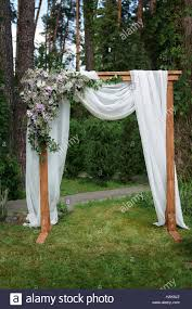 wedding arches decorated with flowers beautiful wedding arch decorated with flowers in the park stock