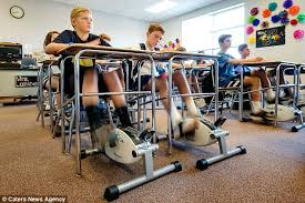under desk foot exerciser teacher installs bike pedals under her students desks to stop them