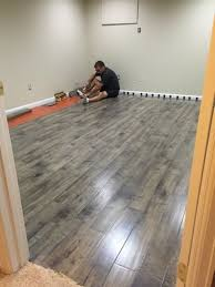 amazing laminate flooring on cement 17 best ideas about basement