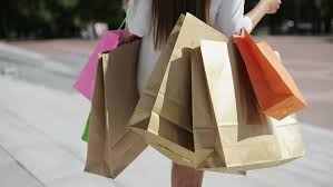 sale consumerism confident with shopping bags walking after