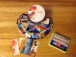 creative business card display for artists slinky powered