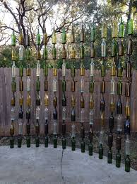so proud of the wine bottle fence we made outdoors