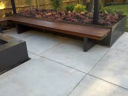 is that a metal planter behind the wood bench i like it
