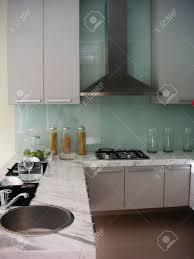modern kitchen stove modern kitchen counter stove hood sink stock photo picture