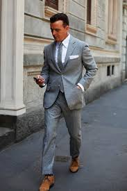 light gray suit brown shoes on the street grey suit milan the sartorialist