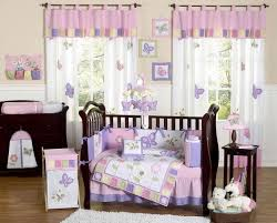 nice design of the nursery pink walls that has brown modern floor
