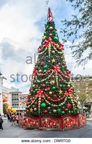 How To Decorate A Large Christmas Tree - christmas tree decorated with big balls at the hall of a