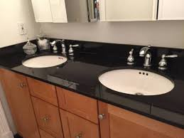 black countertop with black sink classic black granite countertop with double under mounted sinks