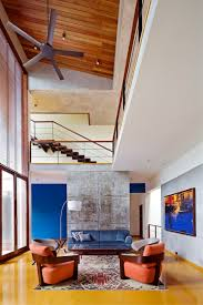 double height windows bring natural light into this home in india