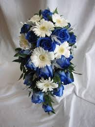 white and blue roses a cascade with blue roses with white gerbera daisies bridal