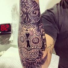 collection of 25 owl roses and skull tattoos on sleeve