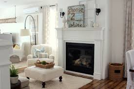 cottage living room with wall sconce hardwood floors zillow