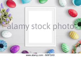 blank easter eggs colorful easter eggs and blank photo frame hanging on rope isolated
