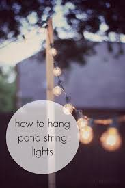 how to hang lights on house how to hang patio string lights for when you don t have something