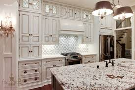 Backsplash With White Kitchen Cabinets Gray Accents And Glass Pendant Lights Backsplash Ideas With White
