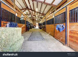 nice large horse stable shed interior stock photo 106425032