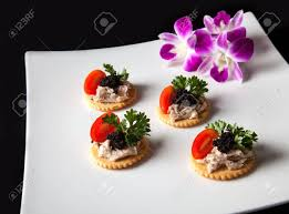 canapé made in canape made from biscuit tuna pate tomato pasley and caviar