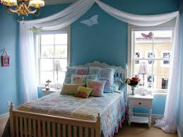 light blue teenage bedroom paint color with wooden furnishing