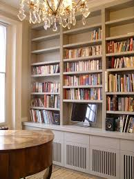 custom built music room bookcase and equipment storage cabinets by