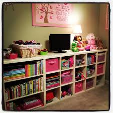 our 4 year old girls room she loves purple we incorporated a my husband built this shelving unit for our 4 year old s bedroom i absolutely