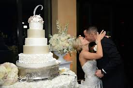 classic white wedding at bella collina party flavors custom cakes