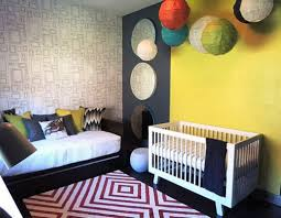 modern nursery with guest room sleeping space and geometric