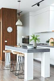 white kitchen orson and black stools concrete bench top kitchen