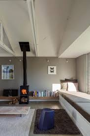 raked ceiling exposed trusses low ceiling over daybed defining