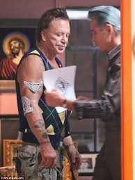mickey rourke whips off his shirt to get another tattoo daily