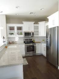 granite countertop cabinets white glass and stone backsplash