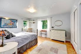 White And Light Grey Bedroom Light Grey Bedroom With Hardwood Floor And Old Rug View Of White