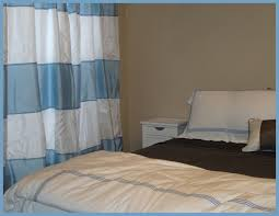 light blue striped curtains blue and white striped fabric curtains connected by beige wall of